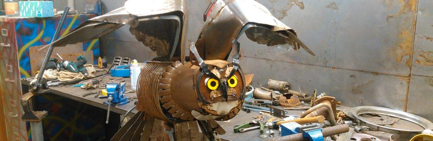 Metal sculpture of a great horned owl