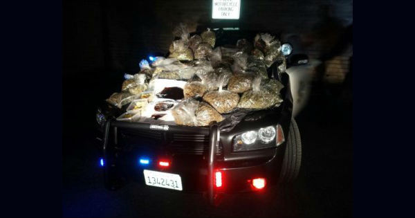 Pounds of marijuana flower and hash on the hood of a Eureka Police car after a man was stopped for speeding in 2015. [Photo from the EPD]
