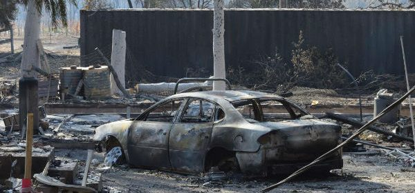 burned car and building in Mendocino Fire