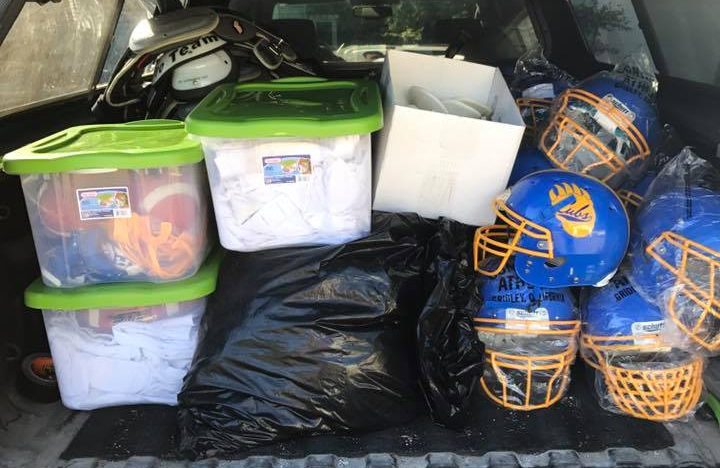 Tubs of football gear