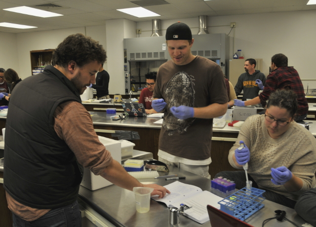 Biological Sciences Professor John Steele (left) and Biology 410 students Patrick Quinn
