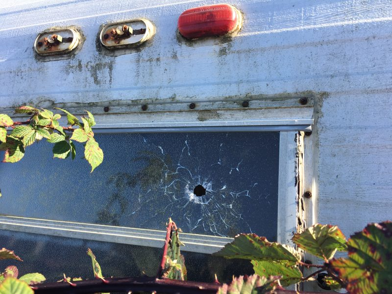 Bullet holes in a trailer