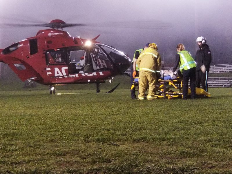 Salmon Creek Fire and the ambulance crew help make sure the patient gets aboard the helicopter.