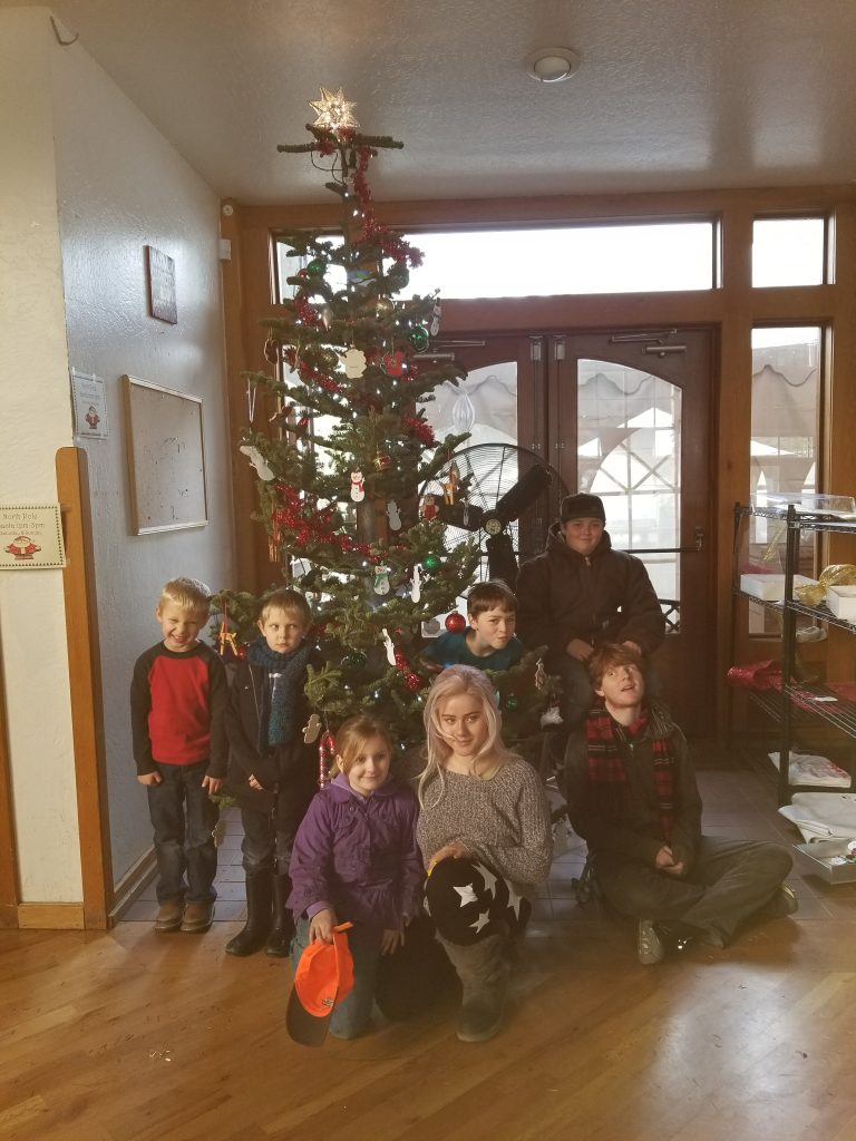 Some of the decorators pose for a photo under the Christmas Tree.