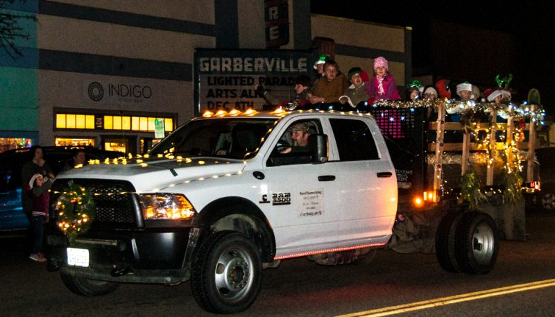 Miranda 4-H's float driving past the Garberville Theater sign.