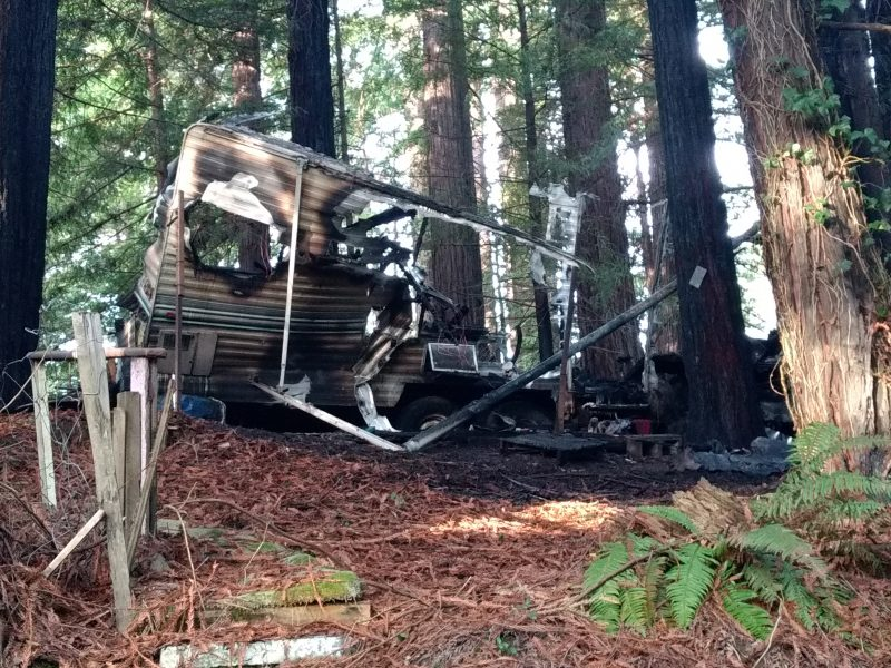 remains of the trailer that caught fire off loop road