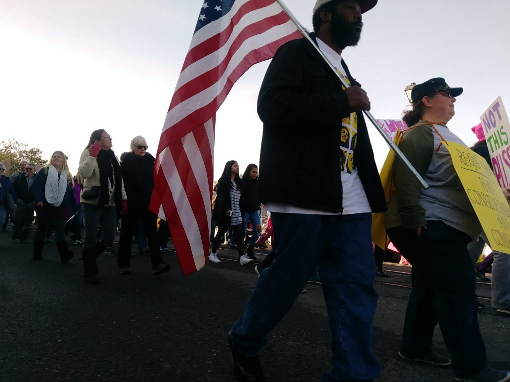 A marcher carries a flag at the 2018 Eureka Women's March.