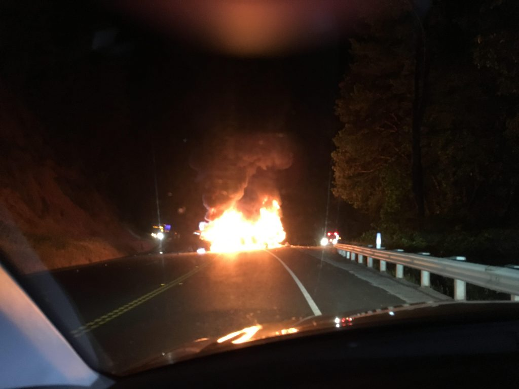 Flames engulf two vehicles and their drivers