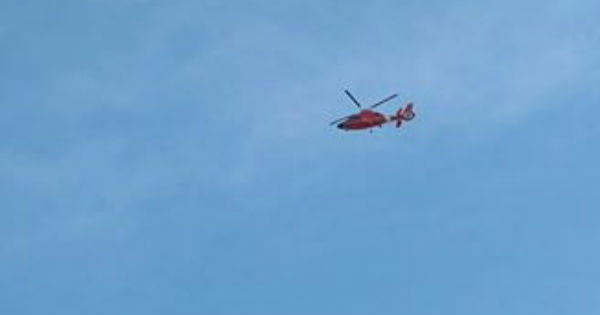 Coast Guard helicopter headed north after the search for the missing crew member was suspended.