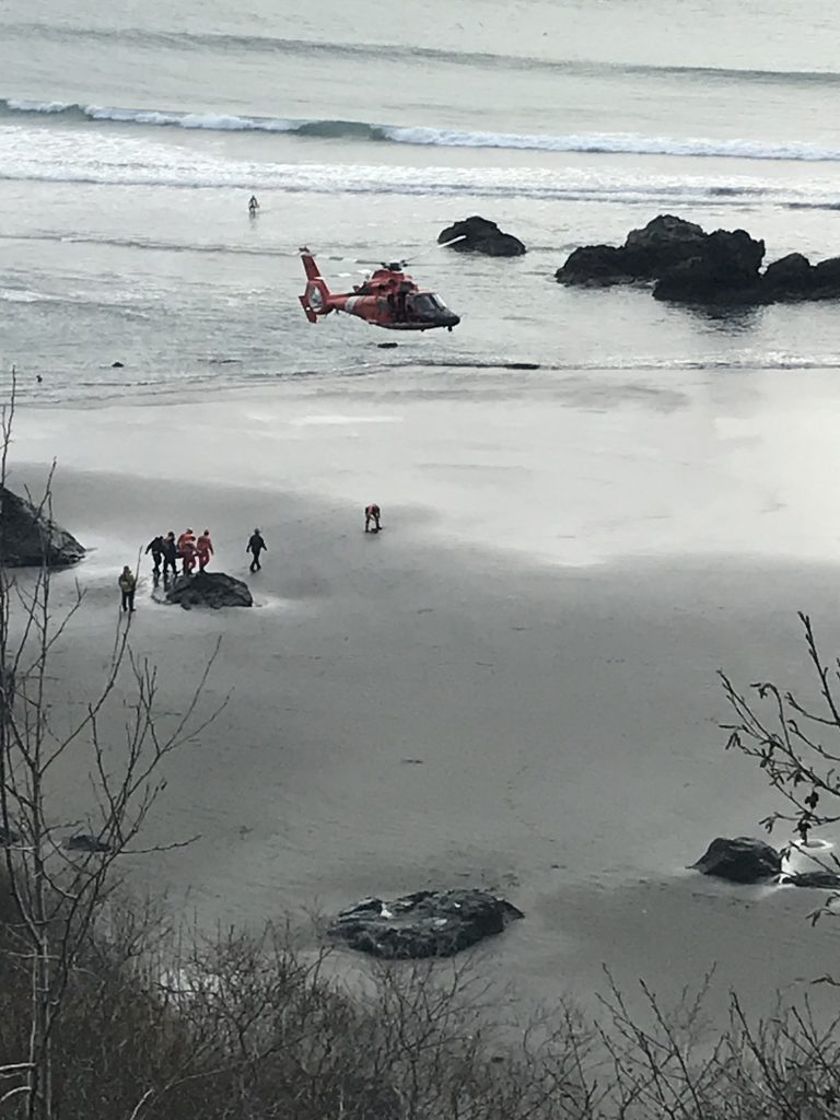 Coast Guard getting ready to lift patient.