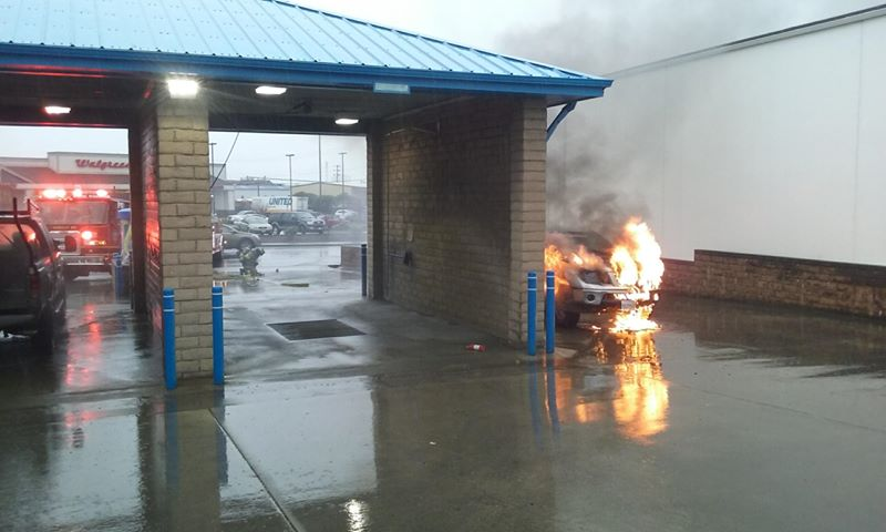 Nissan Frontier on fire in a car wash