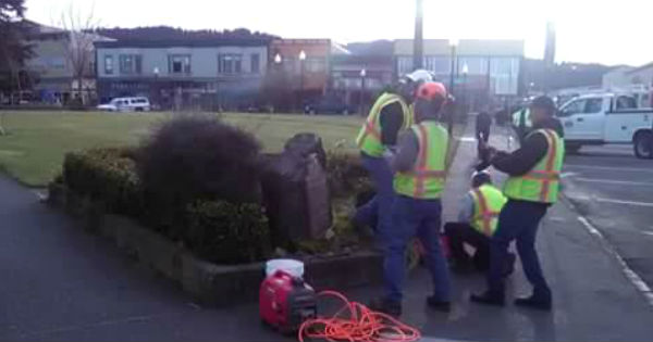 Crews prepare to remove Jacoby building plaque early this morning.  Arcata plaza