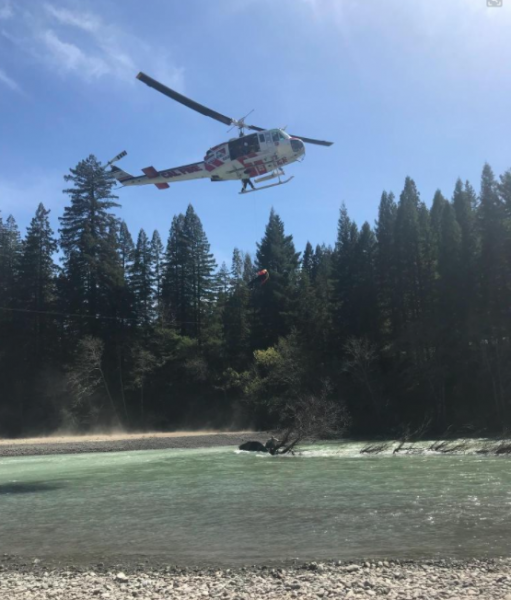 The Cal Fire helicopter rescuing fishermen.