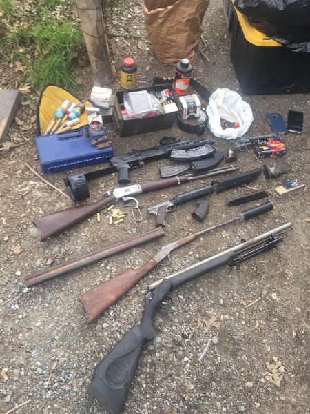Guns and ammunition found during the probation search.