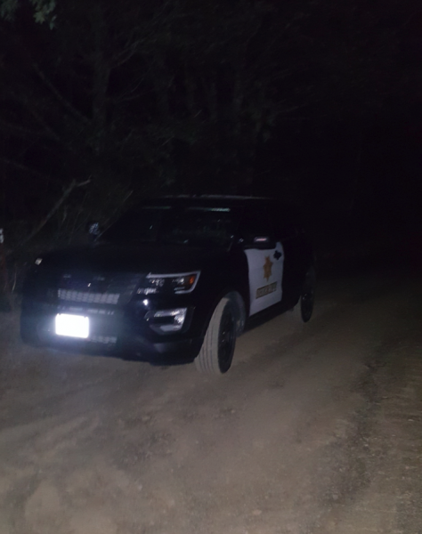 Sheriff vehicle dirt road at dark
