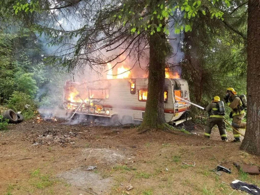Cal Fire fights a blaze in a trailer near Crescent City.