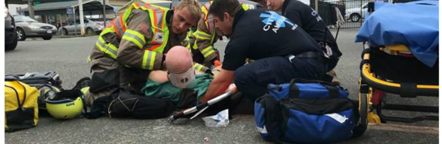 FIreman looks tenderly at wounded man