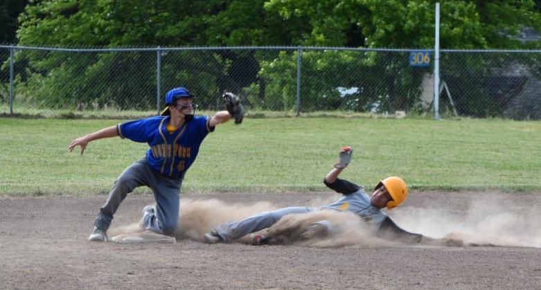 Cooper Scott gets in front of a Panther base runner in a pick-off for the third out