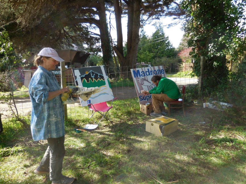 Artists Meig O'Brien and Andrew Daniel use their art to create political signs. [Photos provided by the Madrone for Supervisor campaign]