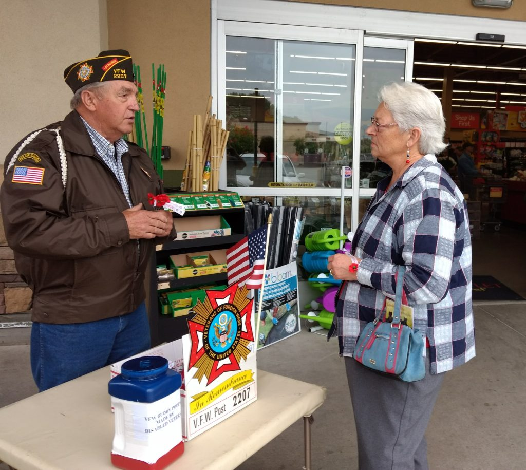 Veteran William Hummel tells a customer about the program.