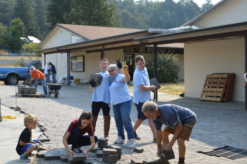 CCUSH helping lay pavers at Redway Elementary School last summer.