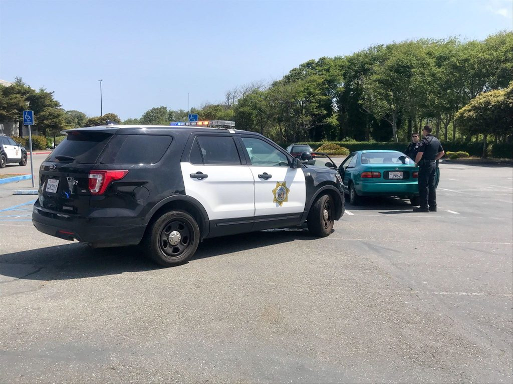 Officers examine a vehicle in connection with the incident.