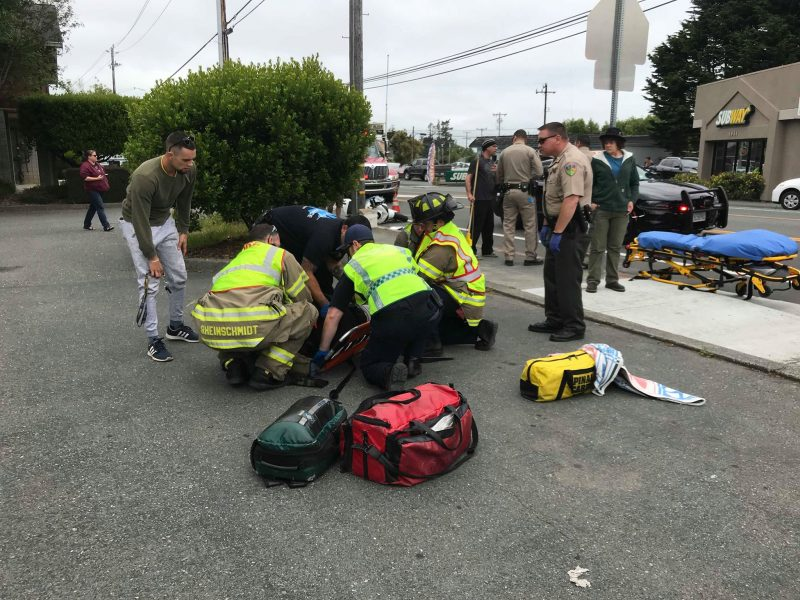 Emergency personnel work on their patient.