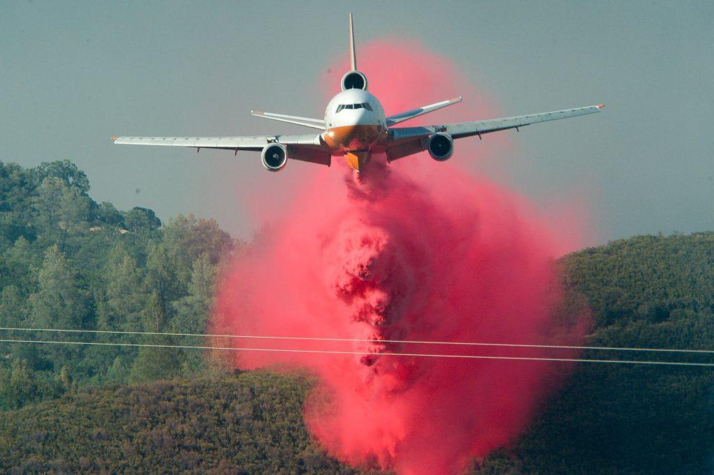 Tanker plane dropping retardant on the Pawnee Fire Sunday.