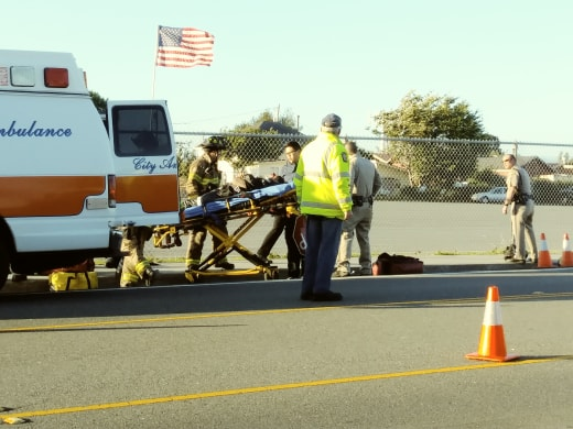 A patient is loaded into an ambulance near Redwood Acres after a motorcycle accident.