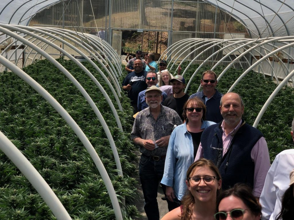 Humboldt County tourism groups tour Huckleberry Hill Farm's cannabis greenhouse.