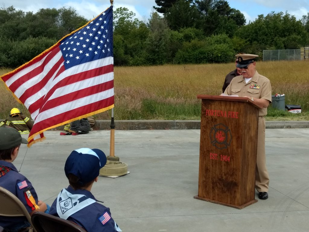 Chief Petty Officer Robert Terry (USN Ret.) speaks to those gathered for the flag retirement.