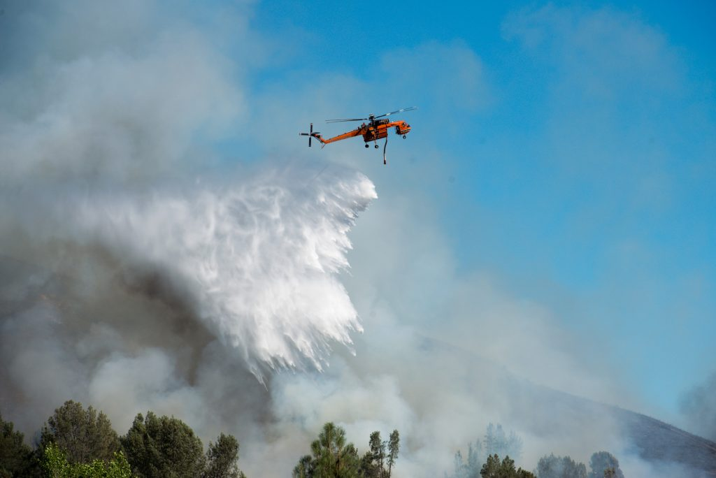 A Sikorsky helicopter drops water on the Pawnee Fire in Lake County California