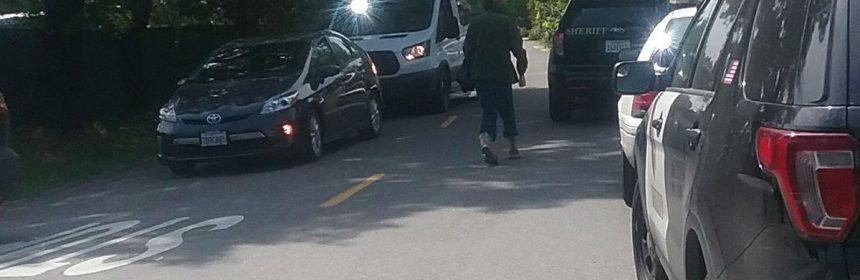 Law enforcement vehicles line Par Avenue in Redway.
