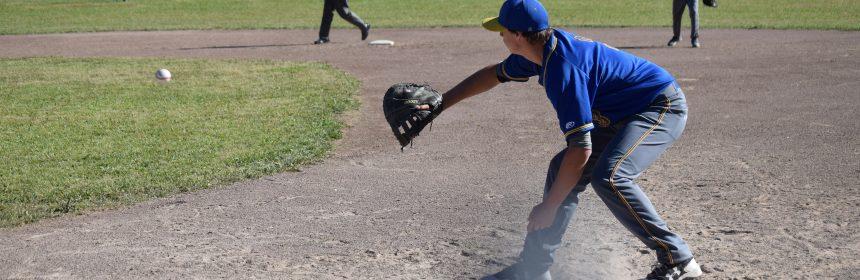 Junior CJ Van Meter accepts a stopped hit by shortstop junior Cooper Scott