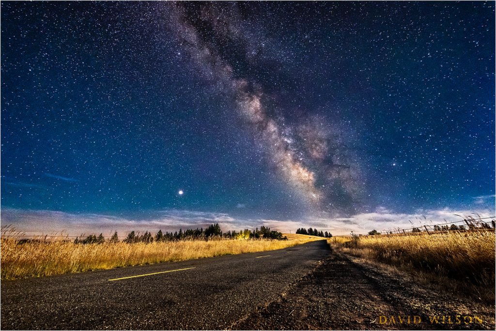 The moonlit Kneeland Road Meets the magnificent Milky Way. July 18, 2018.