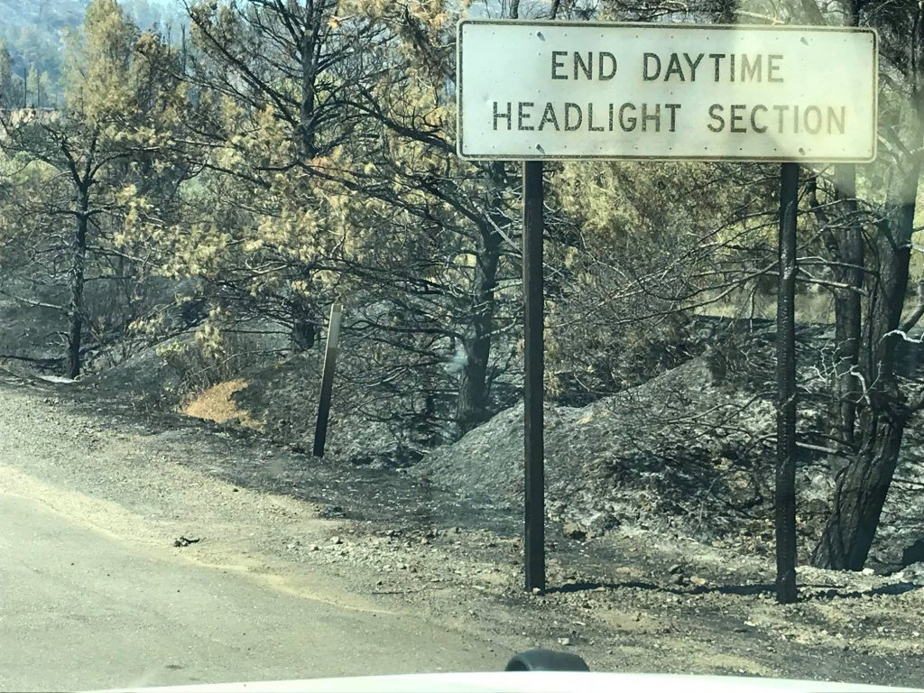 Sign on Hwy 20 damaged by the Pawnee Fire.