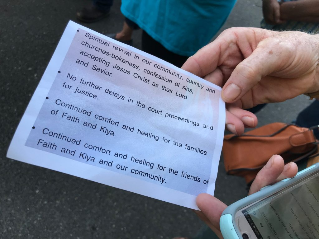 A prayer card held by an attendee.