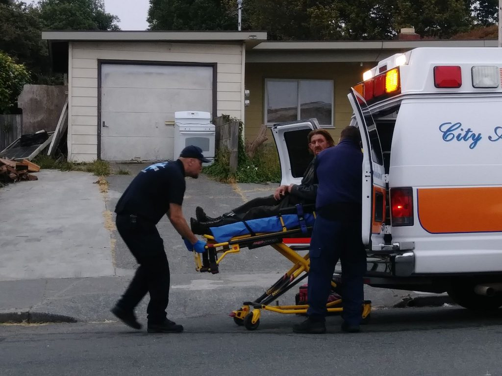 The injured man being loaded into the ambulance