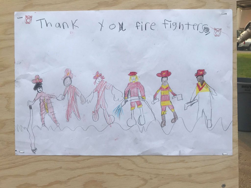 childs drawing on the fire map board at the fire information trailer at the Incident Commander Center. [Photo by Mark McKenna]
