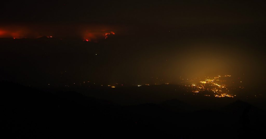 The Carr Fire looms ominously on the hills east of Weaverville.