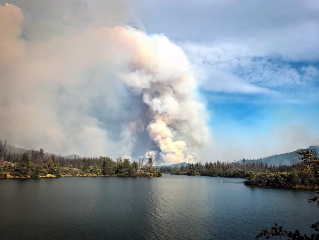 Smoke billowing from the Carr Fire over Whiskeytown lake