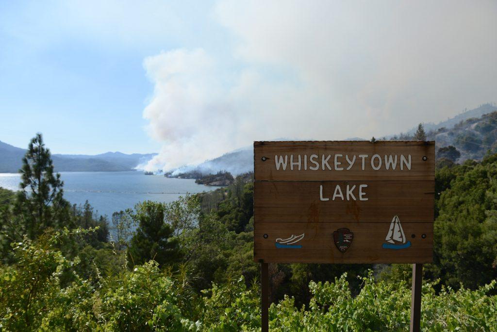 Smoke rises above Whiskeytown Lake.