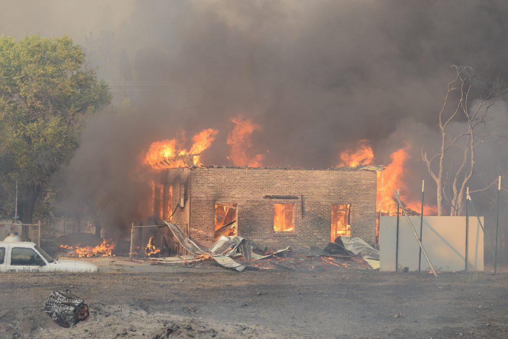 A structure burns in Shasta, California.