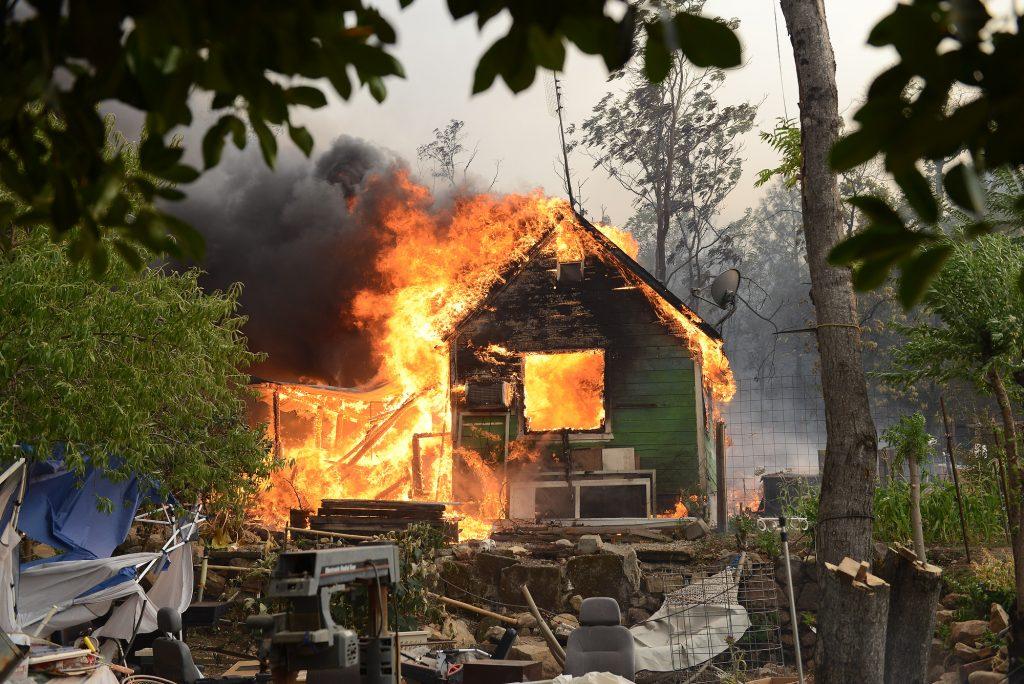 A house burns in Shasta, California.