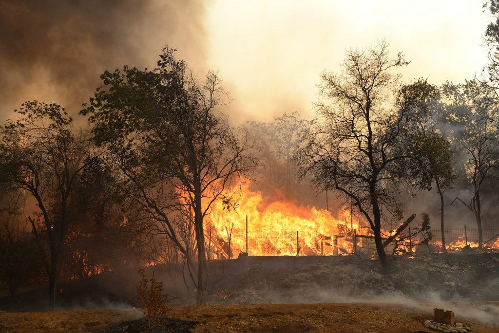 A house burns in the Carr Fire