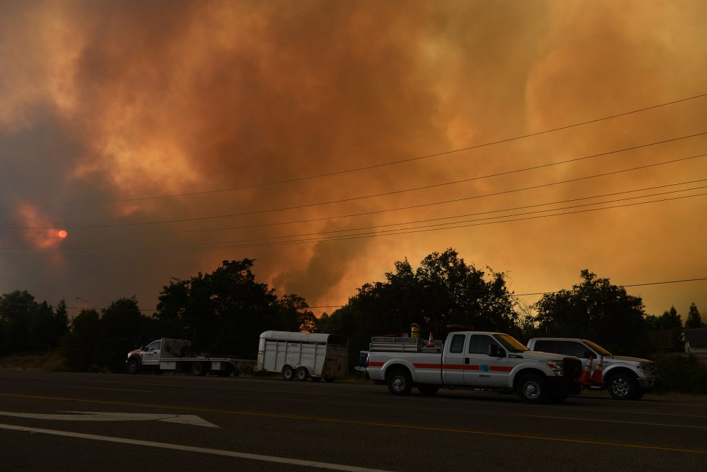 An apocalyptic scene as smoke rises near Redding.