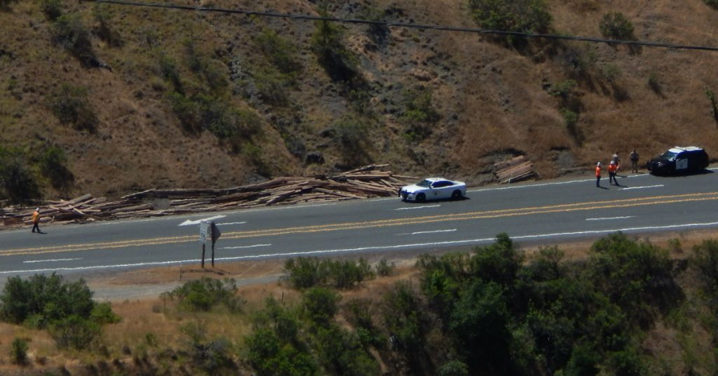 The lumber has been pushed off the road.