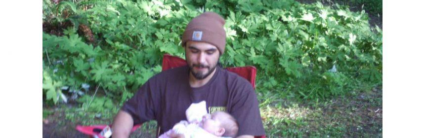 Man looking at child Eddie Koch