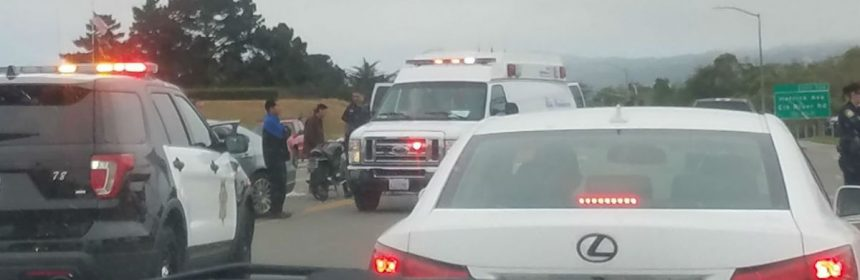 The motorcycle and the ambulance are in the center divide.