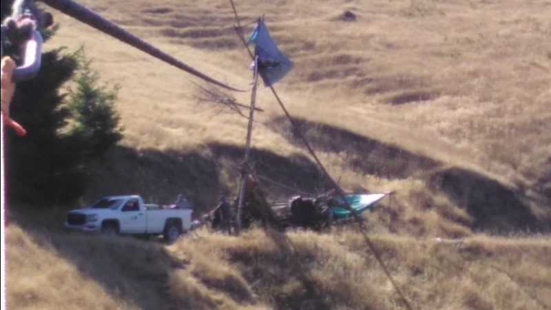 Tripod and vehicle used by Lear Asset logging protest